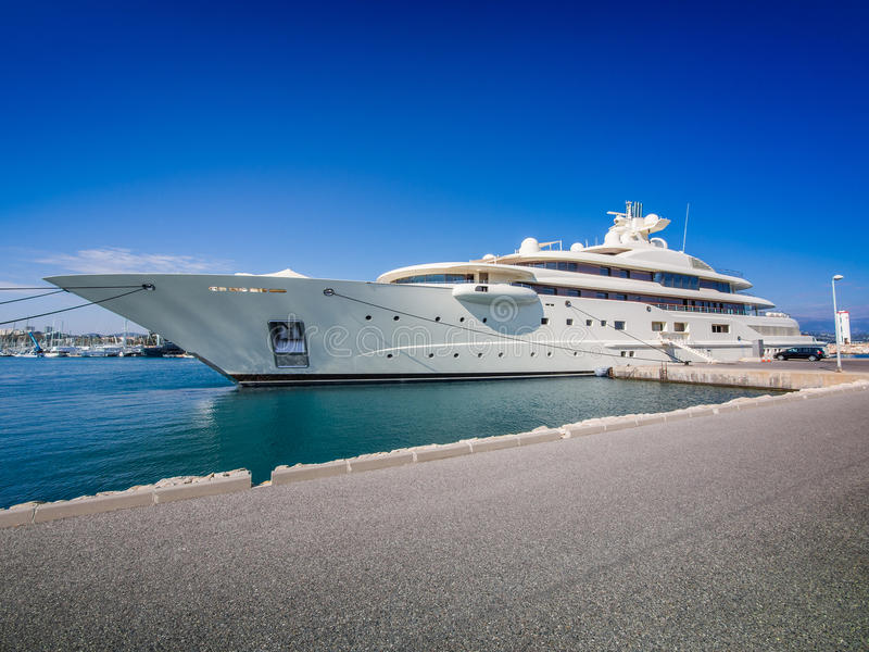 Yacht at dock. Gigantic big and large luxury mega or super motor yacht at dock royalty free stock photography