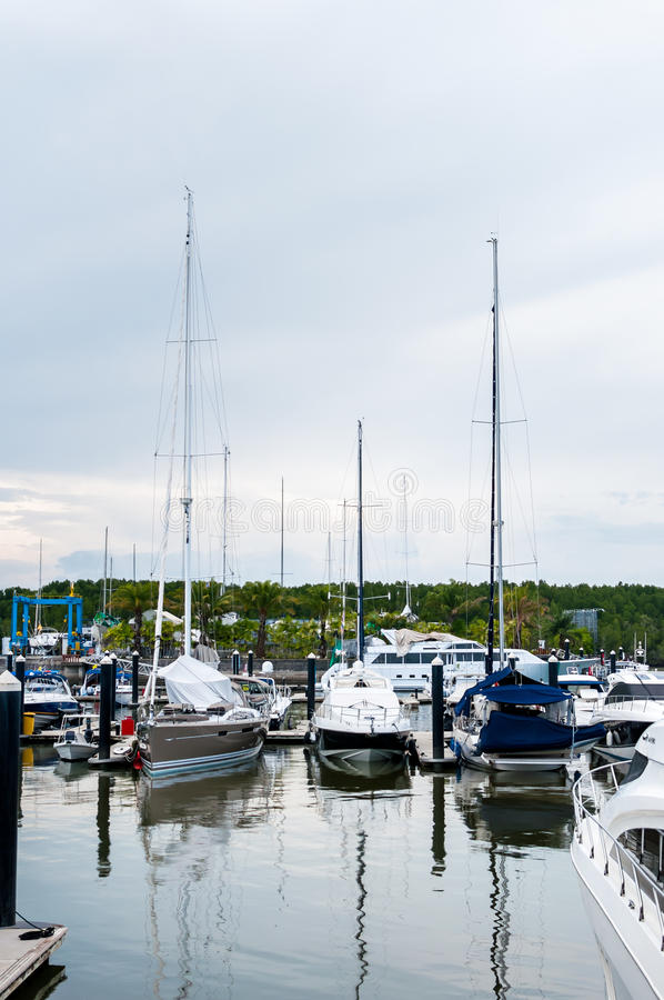 Yacht docking at the marina stock images