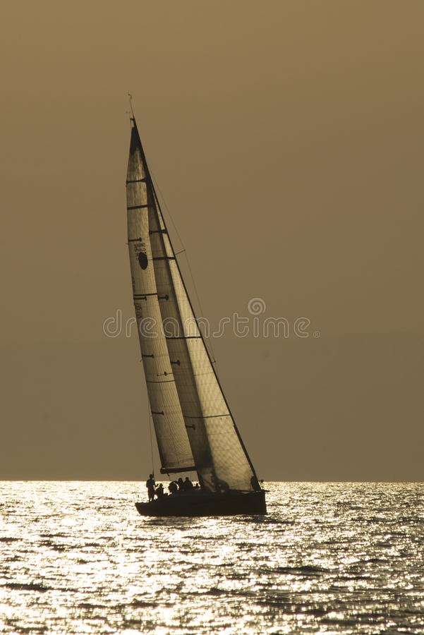 Yacht in evening sea royalty free stock image