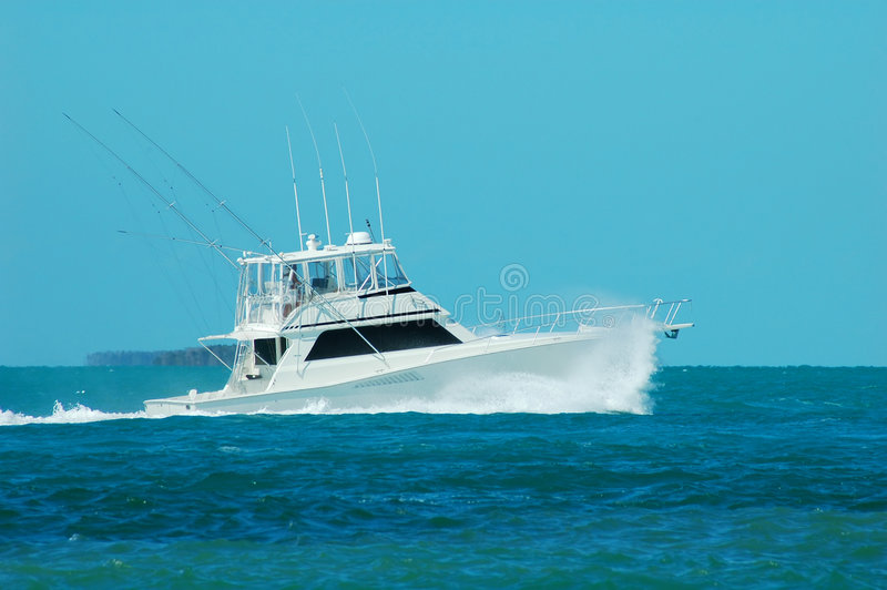 A Yacht fishing boat speeds up stock image