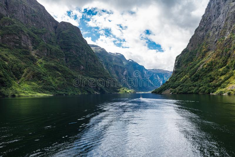 Yacht in Geiranger fjord. Norway stock photography