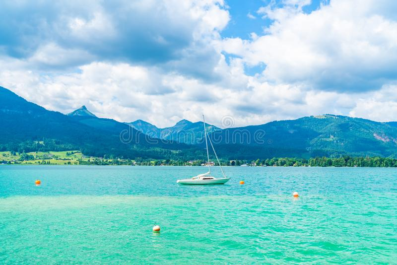 A yacht on Lake Wolfgangsee, Austria. A small yacht on Lake Wolfgangsee in the Salzkammergut resort region, Austria stock photos
