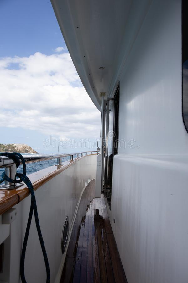 Yacht Life: view of Lipari Island, of the Aeolian Islands, from a luxury private yacht. Boat details royalty free stock photo