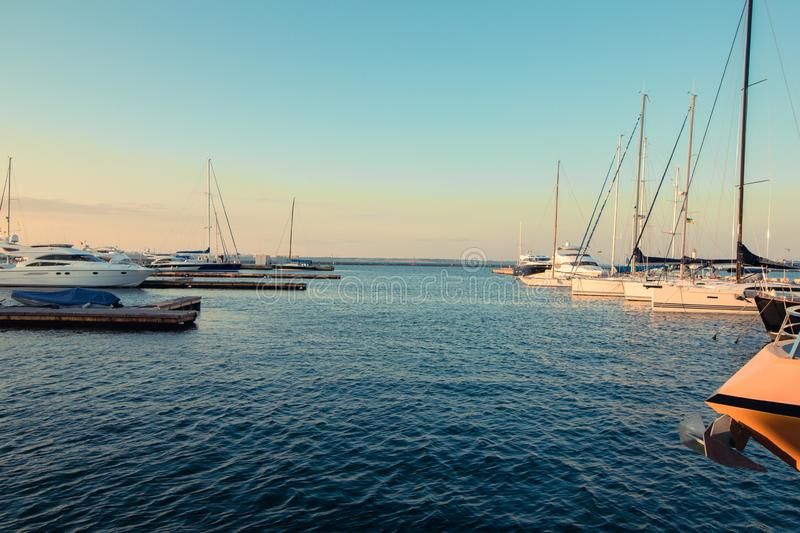 Yacht marina in the evening at the seaside. Romantic photo of harbour in the summer. Travel and lifestyle vacation photo of the stock photo