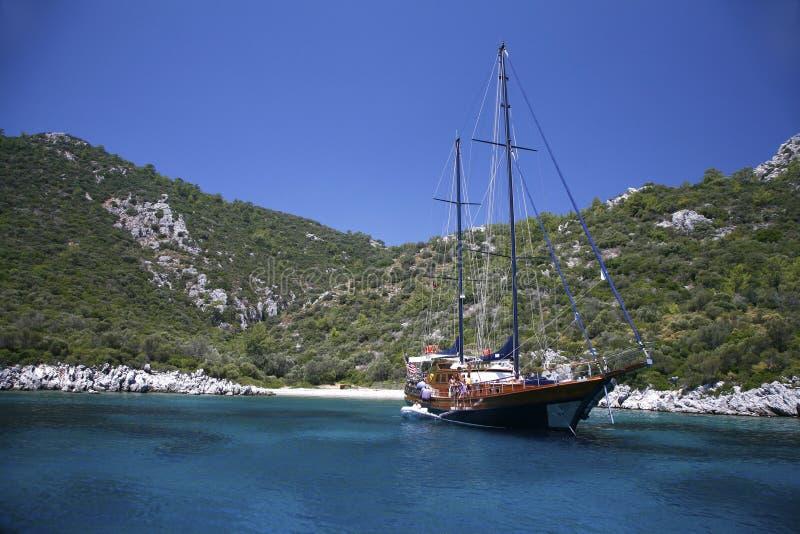 Yacht in a mediterranan bay royalty free stock photos