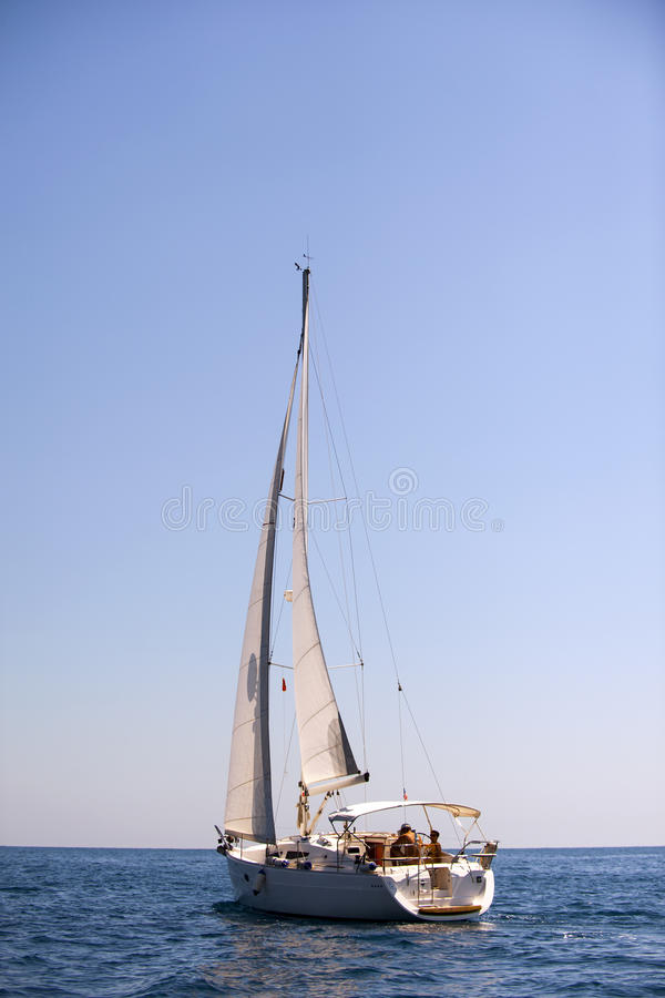 Yacht in the Mediterranean sea on blue sky background royalty free stock image