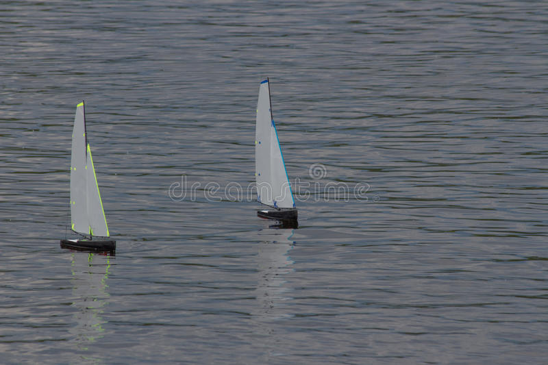 Yacht model. Miniature models of yachts floating on water stock images