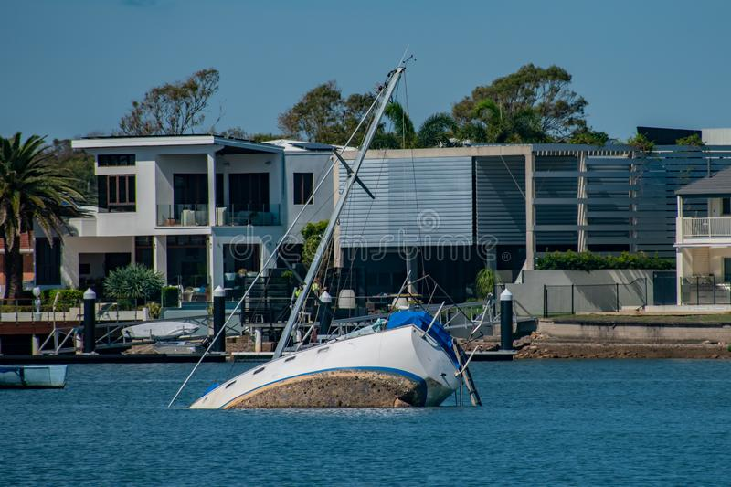 A yacht in Mooloolaba suffered during a storm and partially sunk royalty free stock photos