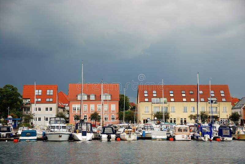 Yacht moorage in Waren, Germany. (Europe) under the rainy sky royalty free stock photo