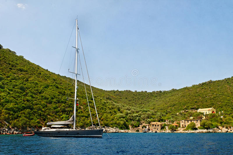 Yacht moored in Porto Leone royalty free stock photography