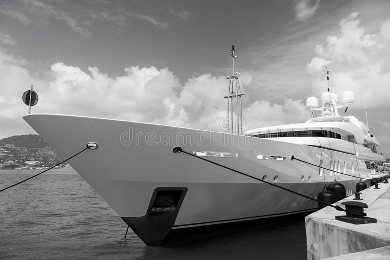 Yacht moored in philipsburg, sint maarten. Ship on sea pier on cloudy blue sky. Luxury travel on yacht, wanderlust stock photos