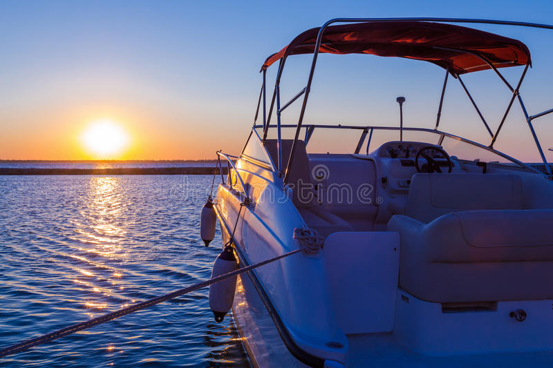 Yacht near the pier against sunset stock image