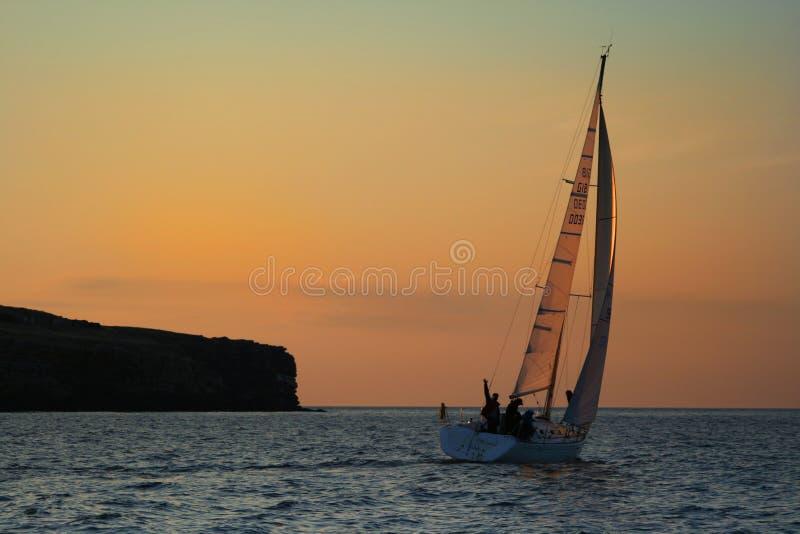 Yacht near to an island. stock photo