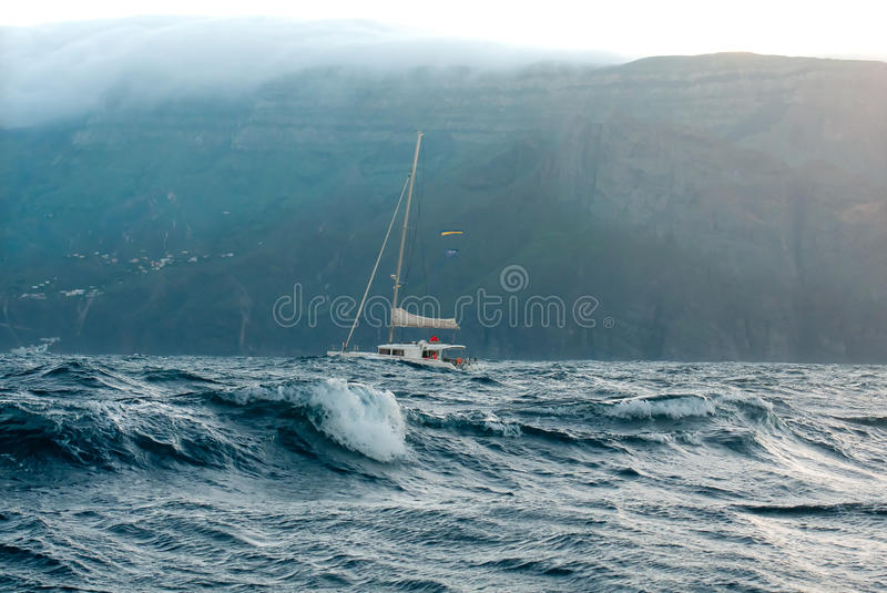Yacht in the ocean. Yacht catamaran in the stormy ocean near the island of La Gomera stock images