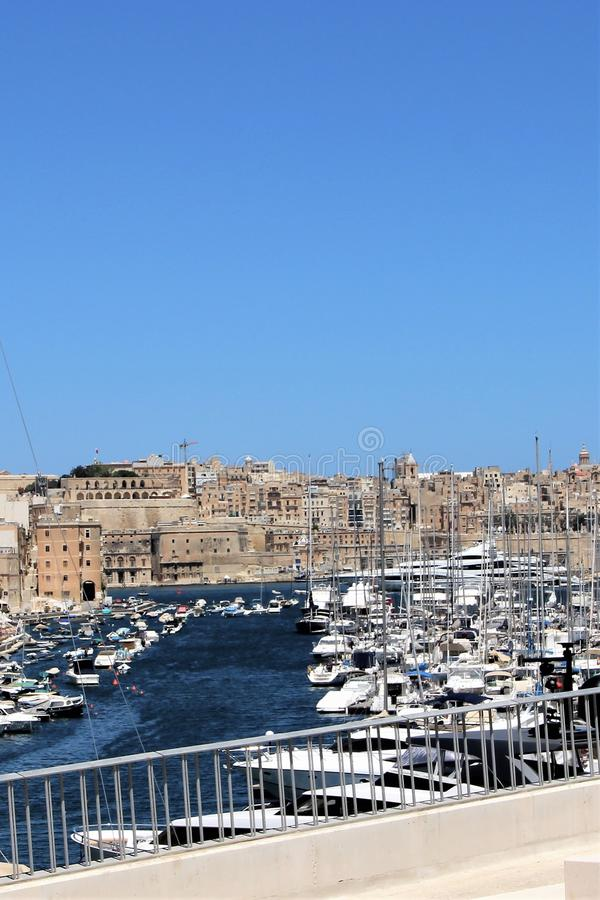Yacht parking in the harbor and view of the capital of the island of Malta, Valletta. Snow-white yachts that came from different countries of the world in a royalty free stock image