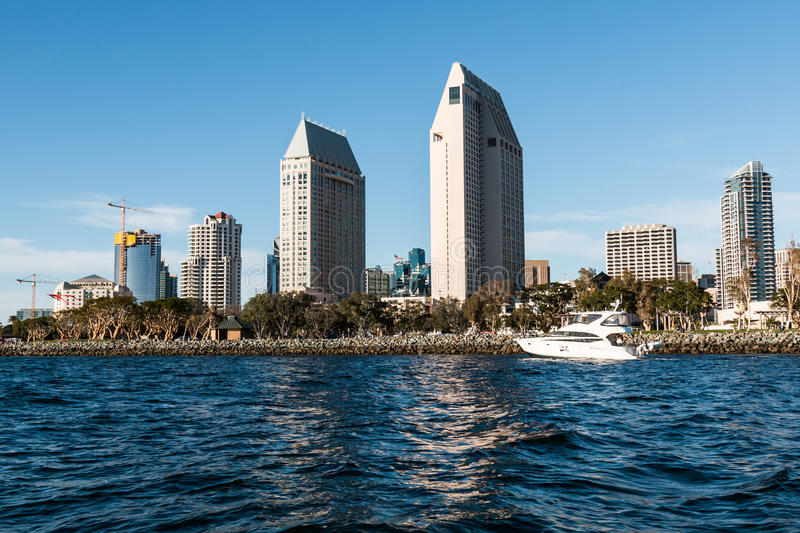 A Yacht Passes by the Downtown San Diego Skyline royalty free stock images