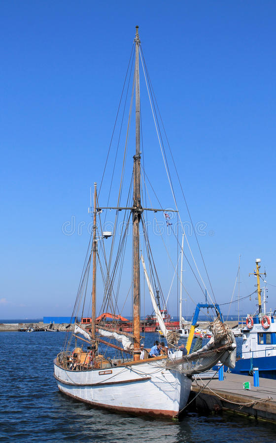 YACHT AT THE PIER. ESTONIA, TALLINN / JULY 24 / 2014 - Yacht at the pier in port royalty free stock images