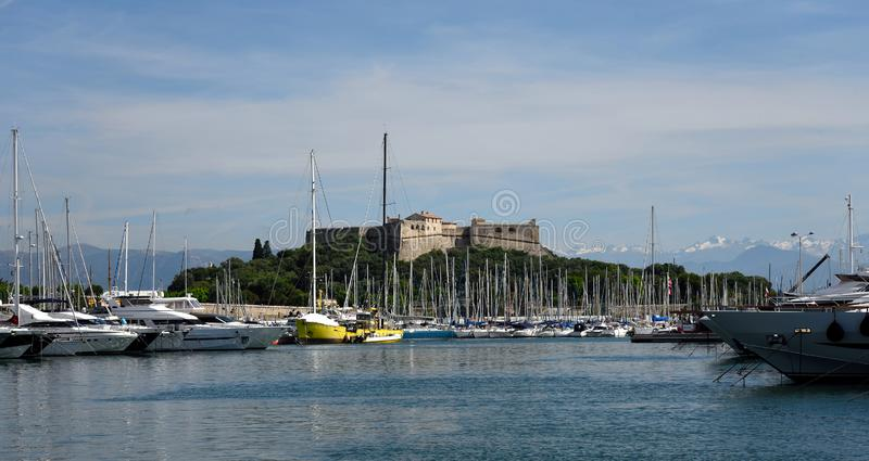 Yacht port Vauban Antibes. Boats moored in port Vauban Antibes with Fort Carre in background. France. Summer. 2018 royalty free stock photo