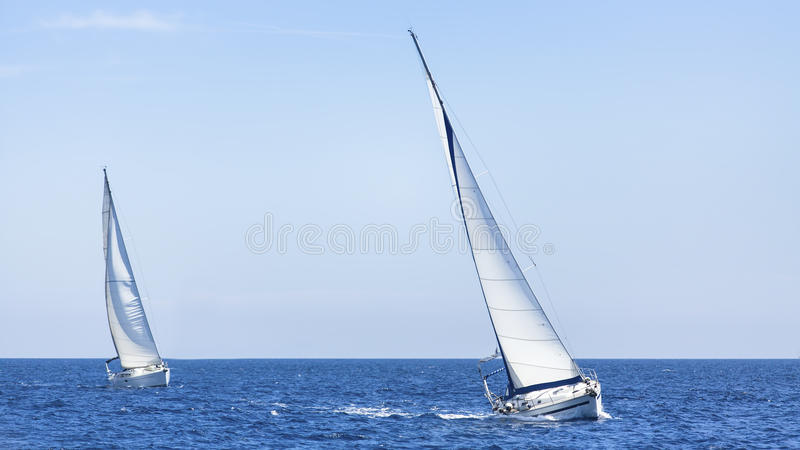 Yacht race in the open sea. Sailing. Luxury yachts. Travel. royalty free stock image