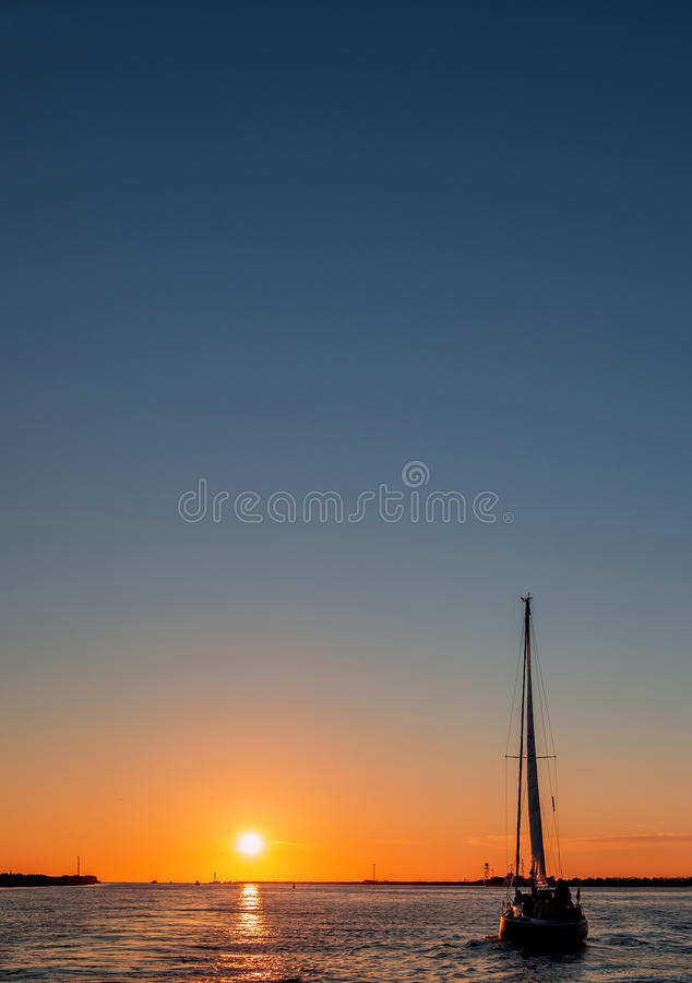 Yacht sailing against sunset royalty free stock photos