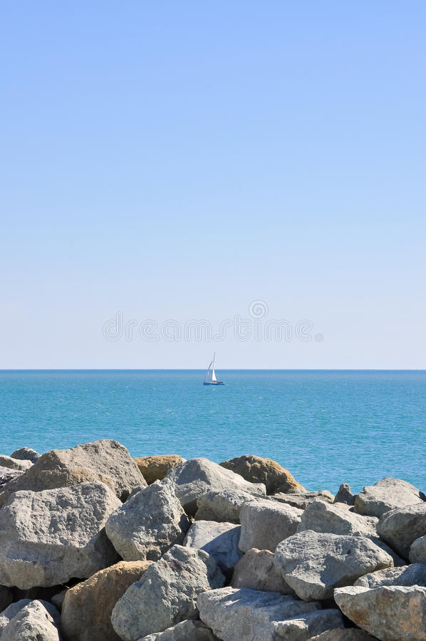 A yacht sailing in the open sea a clear day royalty free stock image