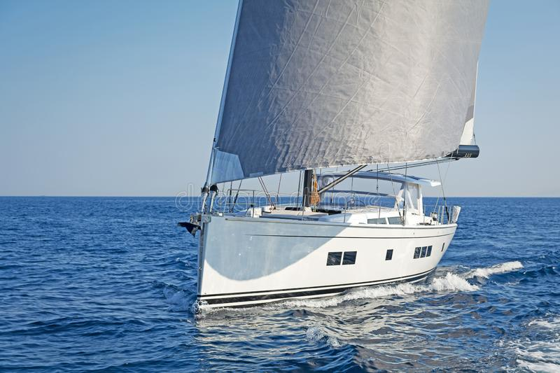 Yacht sailing in open sea at windy day stock photo