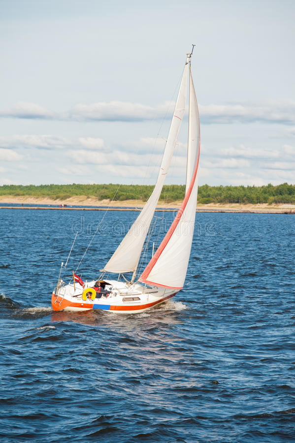 Yacht sailing in sea royalty free stock photos