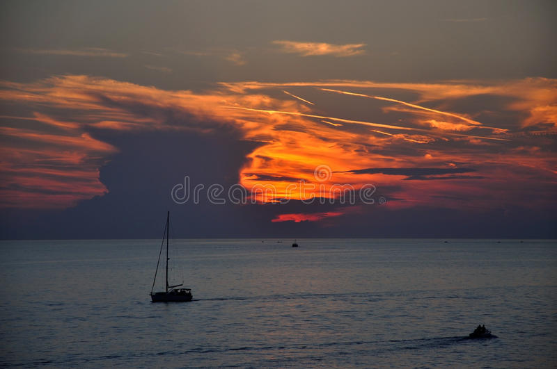 A yacht sailing on the sea stock photo