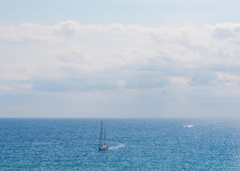 Yacht sailing the sea, clear sky and blue water, recreational sp royalty free stock photo