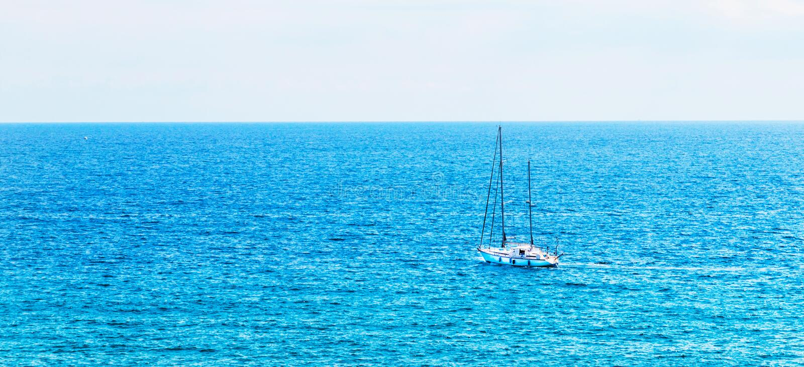 Yacht sailing the sea, clear sky and blue water, recreational sp stock photos