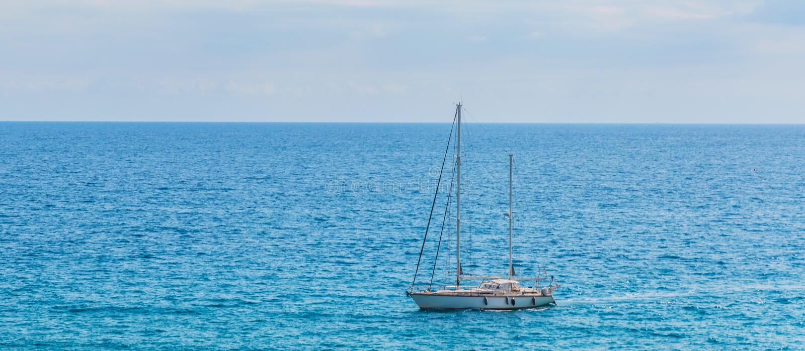 Yacht sailing the sea, clear sky and blue water, recreational sp royalty free stock photography