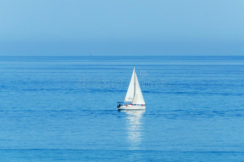 Yacht sailing the sea, clear sky and blue water, recreational sport, active rest stock images
