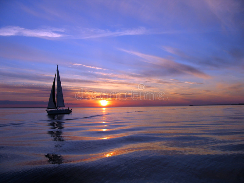 Yacht Sailing At Sunset Royalty Free Stock Photos