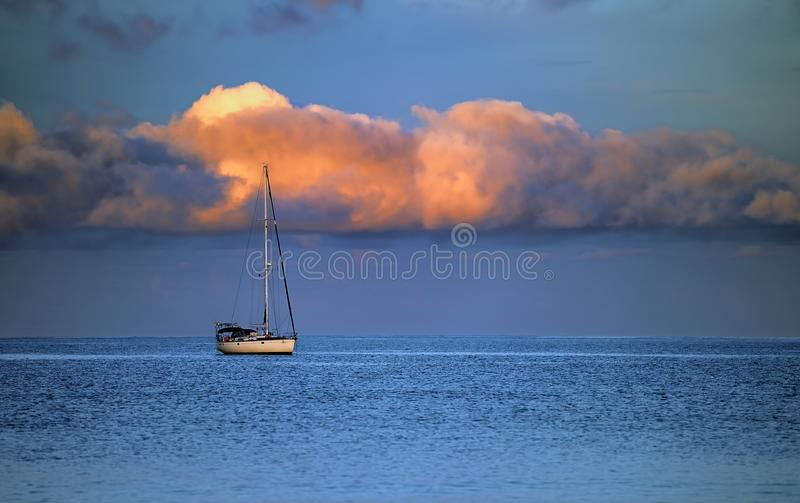 Yacht, sea and cloud royalty free stock photo