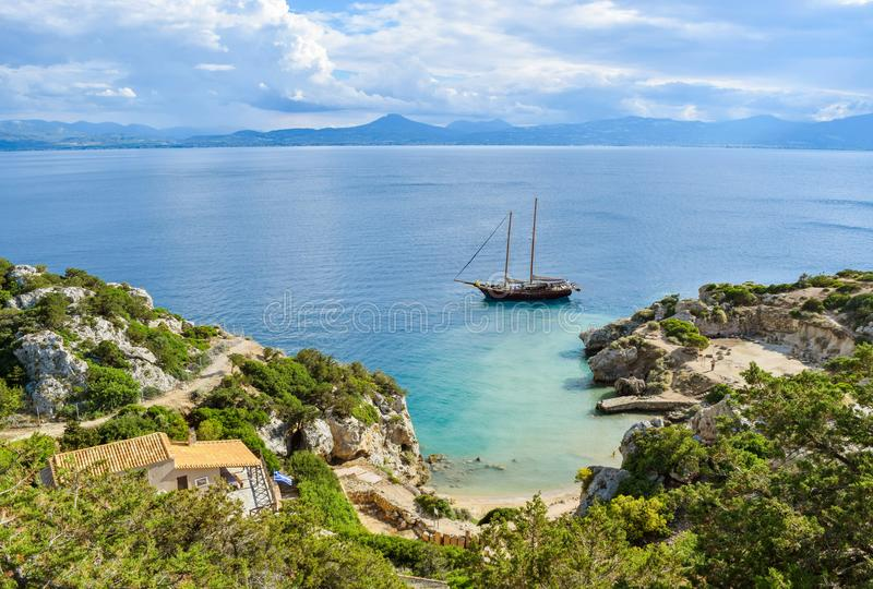 Yacht in small cove. The small cove of the Corinthian gulf near Heraion of Perachora, Greece royalty free stock photo