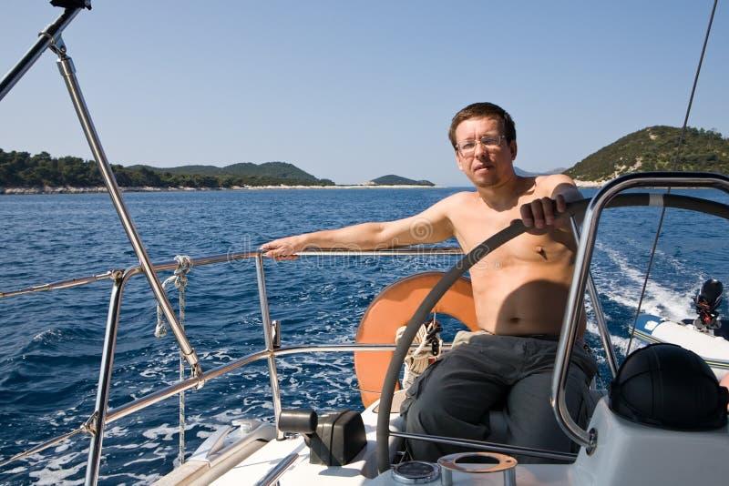 Yacht steersman royalty free stock photos
