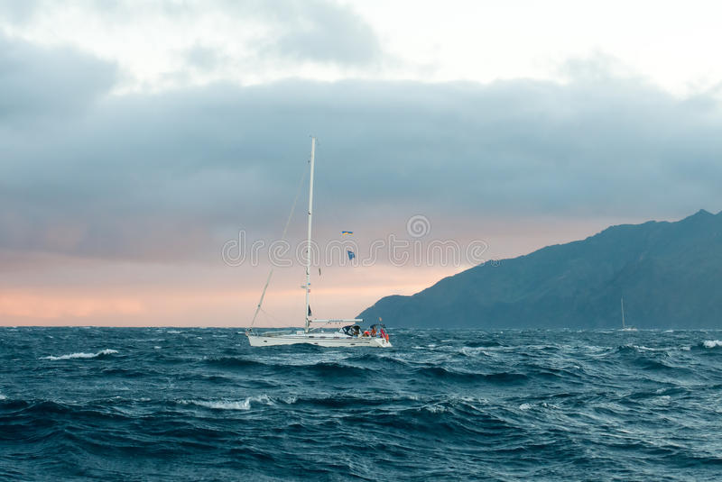 Yacht in the stormy ocean. Near the island of La Gomera royalty free stock photos