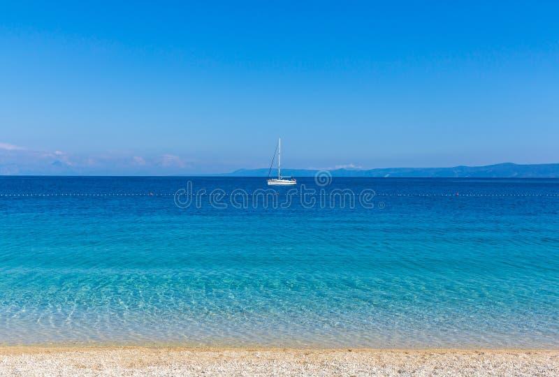Yacht on stunning bay in Croatia. Brac, Croatia - May 07, 2016: yacht at Zlatni Rat beach, Croatia royalty free stock photos