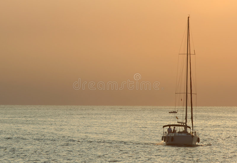 Yacht at sunset royalty free stock images