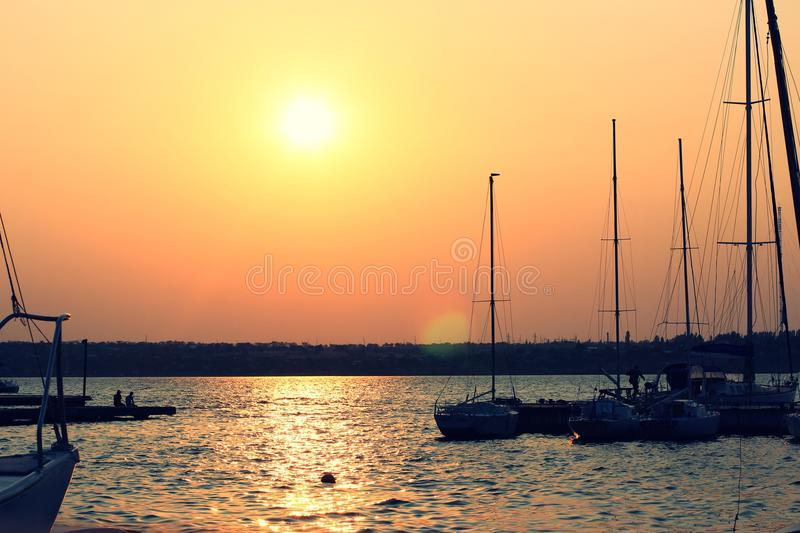 Yacht at sunset royalty free stock photo