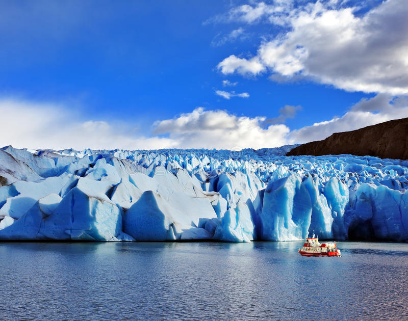 Yacht for tourists near the Glacier Grey. Yacht for tourists near the magnificent Glacier Grey Lake Grey. Sunny and windy summer day in the national park Torres royalty free stock image