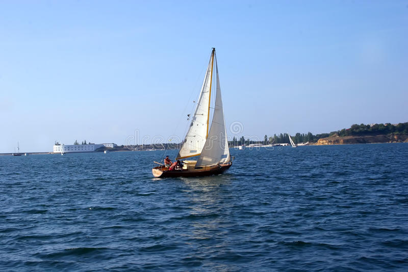 Yacht under a sail royalty free stock photo
