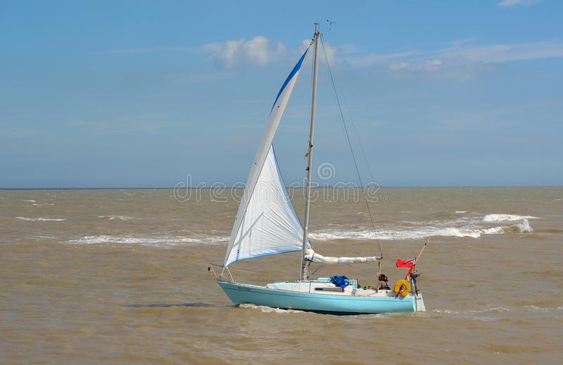 Yacht under sail at the estuary of the river Deben at Felixstowe Ferry. royalty free stock image