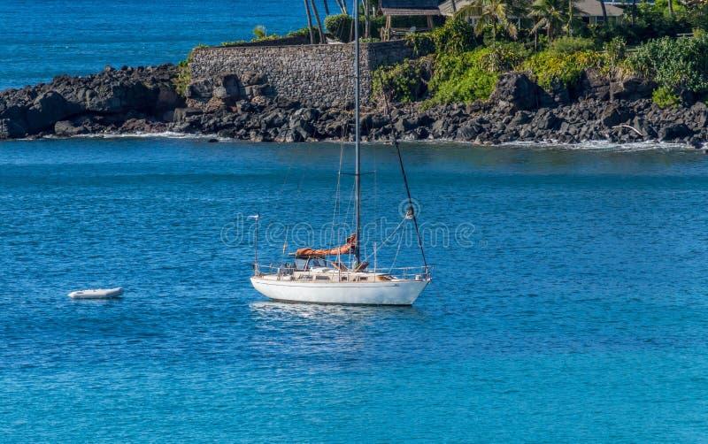 Yacht in Waimea Bay. A yacht anchored in Waimea Bay, Hawaii stock photos