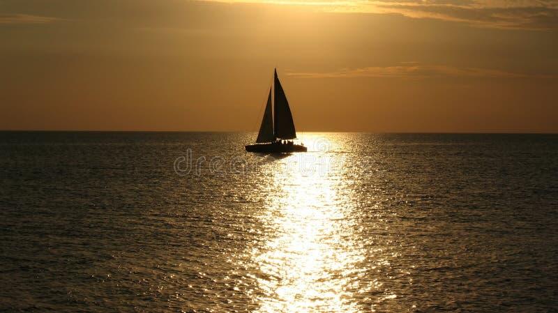 Yacht at sunset on the sea stock photos