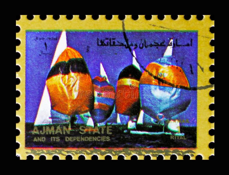 Yachting, Summer Olympics serie, circa 1973. MOSCOW, RUSSIA - NOVEMBER 10, 2018: A stamp printed in Ajman shows Yachting, Summer Olympics serie, circa 1973 stock photo