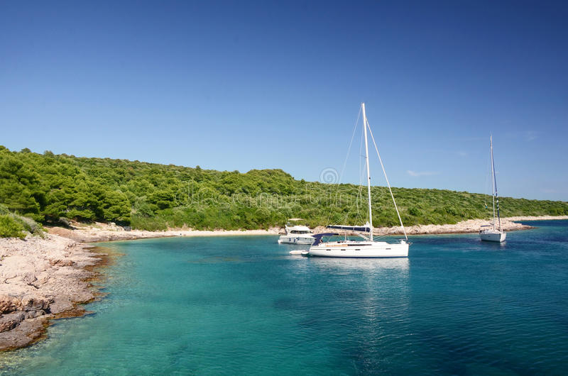 Yachts anchoring on the coast of Croatia royalty free stock images