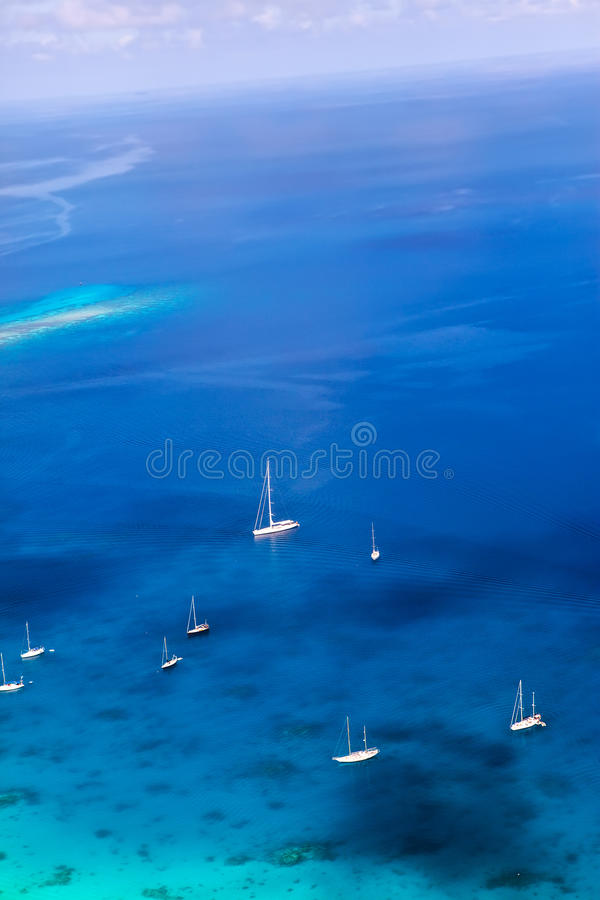 Yachts in a bay. Aerial view. Landscape in a sunny day royalty free stock photography