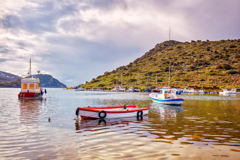 Yachts and boats anchored over the calm sea at gumusluk bay stock photo