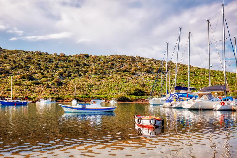 Yachts and boats anchored over the calm sea royalty free stock image